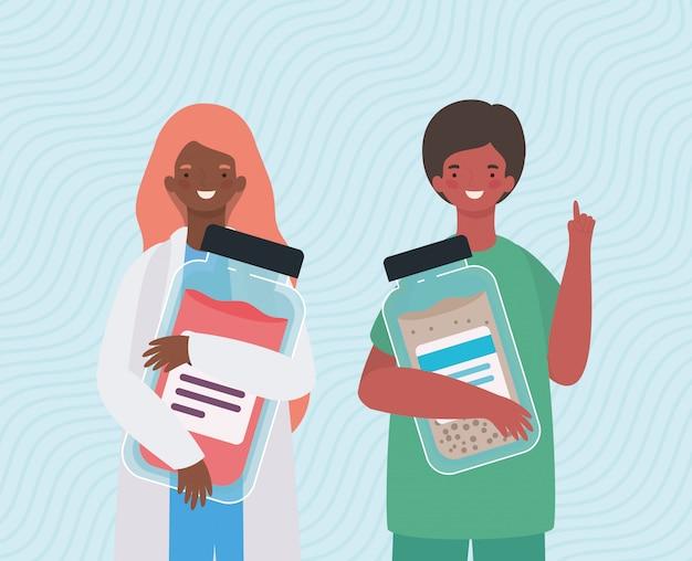 Médicos femininos e masculinos com frascos de remédios Vetor Premium