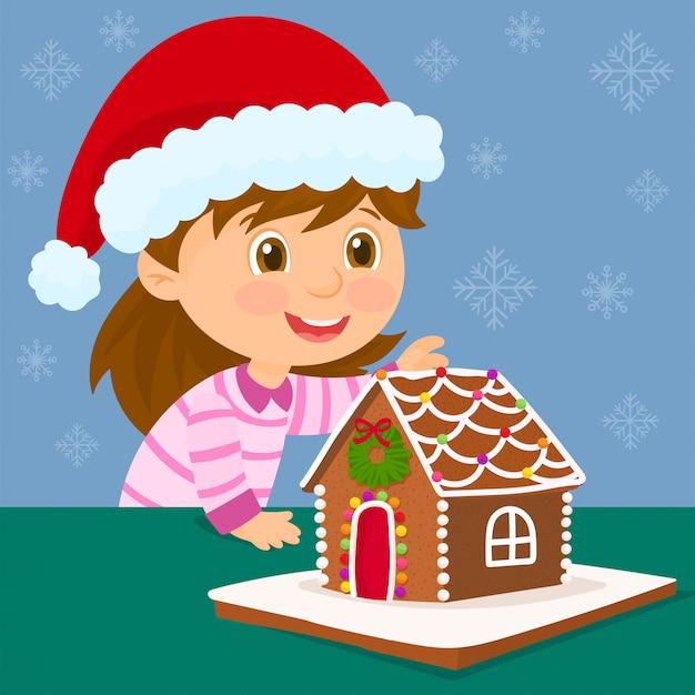 Menina com chapéu de papai noel e casa de gengibre de natal Vetor Premium