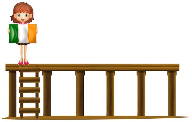 Menina, segurando, bandeira, de, irlanda, ligado, ponte Vetor grátis