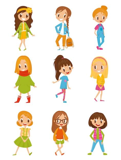 Meninas bonito dos desenhos animados em roupas da moda conjunto ilustrações sobre um fundo branco Vetor Premium