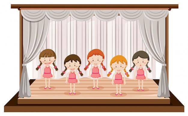 Meninas executam balé no palco Vetor Premium