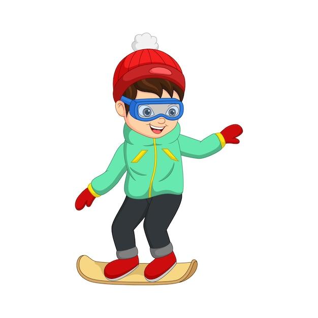 Menino bonitinho com roupas de inverno jogando snowboard Vetor Premium