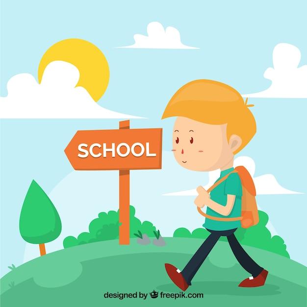 Menino com mochila caminhando para a escola Vetor grátis