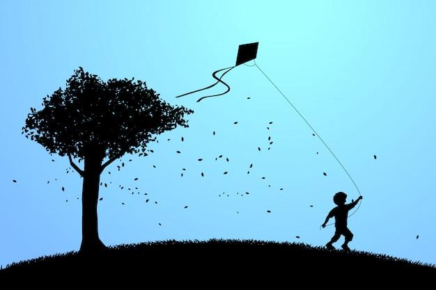 Menino correndo com pipa voando no céu com uma árvore grande. Vetor Premium