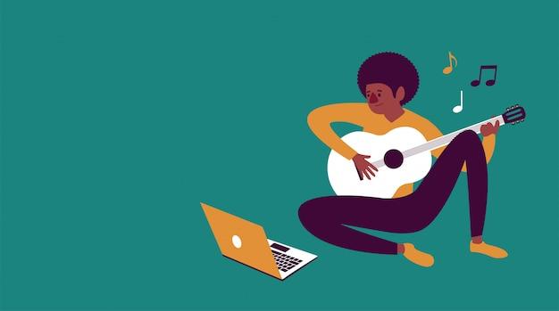 Menino e-learning para tocar violão com um laptop em casa Vetor Premium