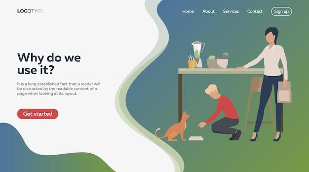Menino e mulher alimentando gato na cozinha Vetor grátis