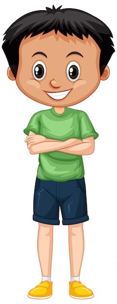 Menino em pé de camisa verde isolado Vetor grátis