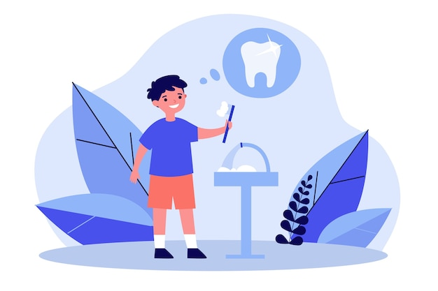 Menino sorridente a limpar os dentes pela saúde Vetor Premium
