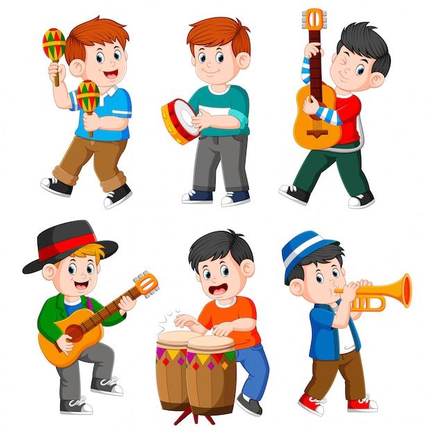 Menino, tocando, com, diferente, instrumentos musicais Vetor Premium