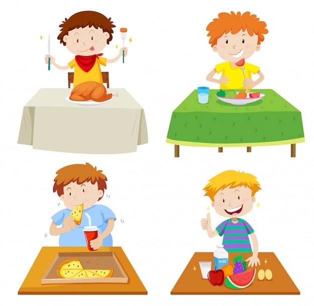 Meninos comendo na mesa de jantar Vetor grátis