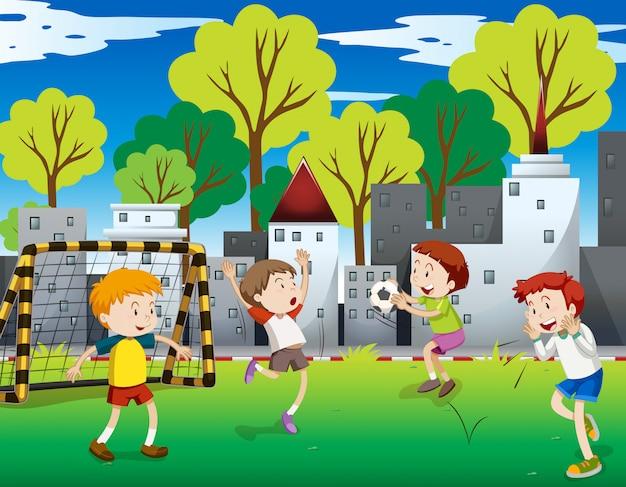Meninos jogando futebol no campo Vetor grátis
