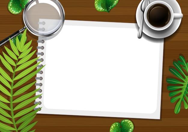 Mesa de trabalho de escritório com vista superior com elementos de escritório com folhas verdes Vetor grátis