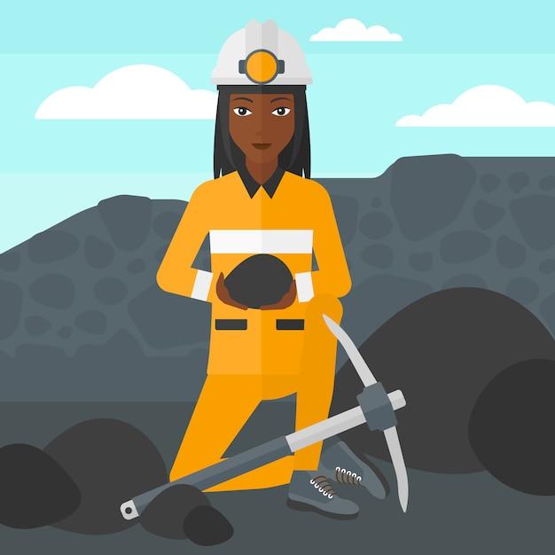 Mineiro, segurando o carvão nas mãos Vetor Premium