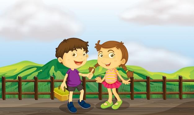 Moça e menino na ponte de madeira Vetor grátis