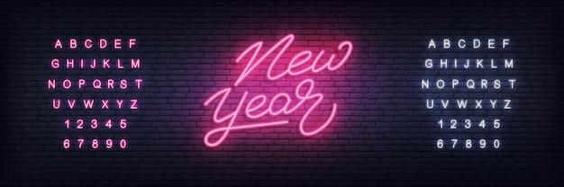 Modelo de banner de ano novo de néon Vetor Premium
