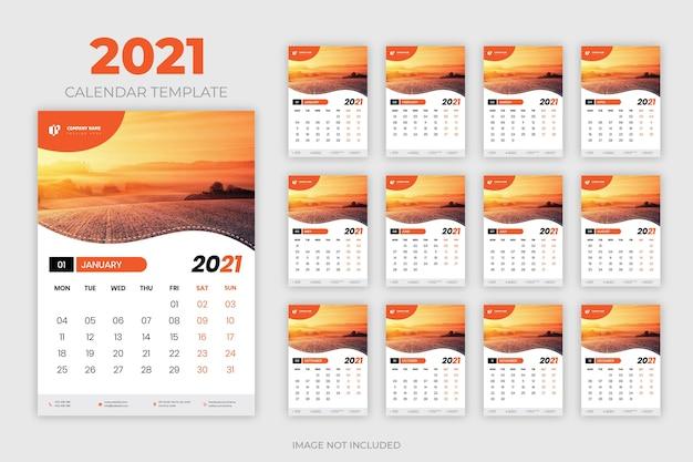 Modelo de calendário de parede 2021 Vetor Premium