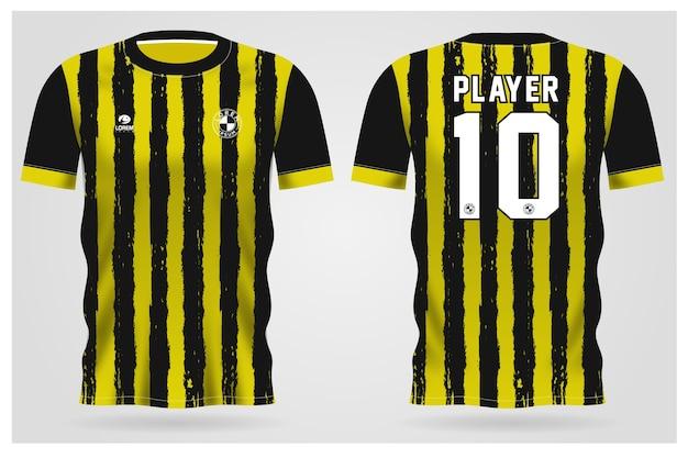 Modelo de camisa esporte preta amarela grunge para uniformes de equipe e design de camisetas de futebol Vetor Premium