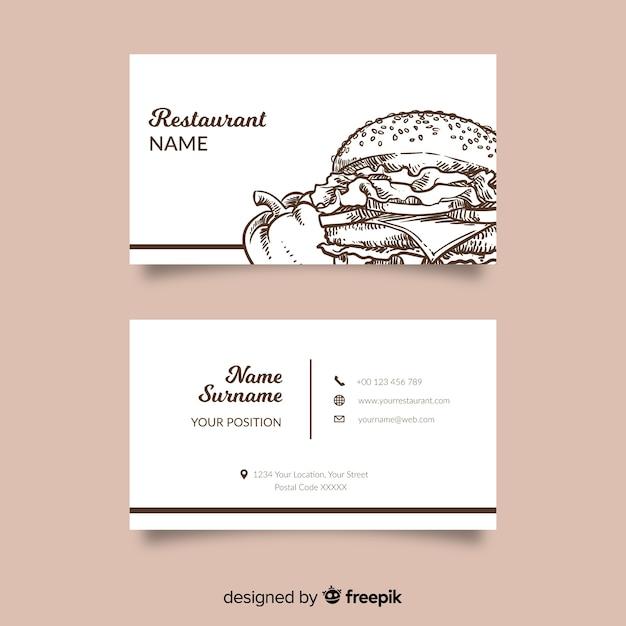 Modelo de cartão de restaurante desenhado mão Vetor grátis