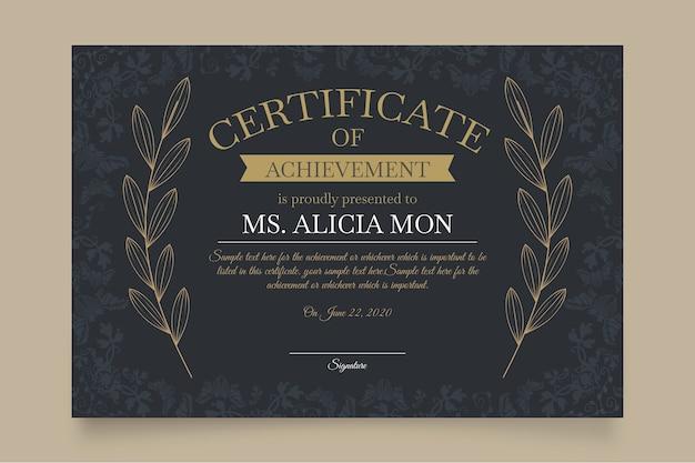 Modelo de certificado elegante com folhas Vetor grátis
