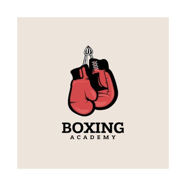 Modelo de logotipo de boxe com luvas de boxe de suspensão. Vetor Premium