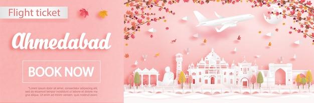 Modelo de publicidade de voo e bilhete com viagens para ahmedabad, índia na temporada de outono lidar com folhas de bordo caindo e marcos famosos em estilo de corte de papel Vetor Premium