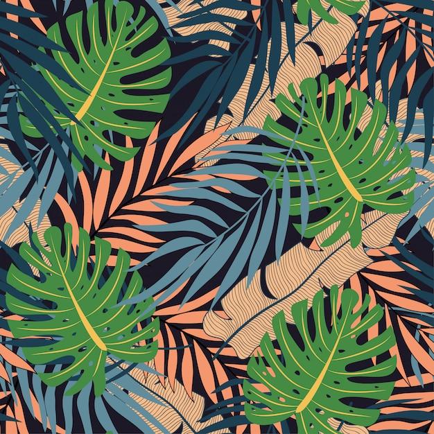 Moderno sem costura padrão tropical com plantas e folhas Vetor Premium