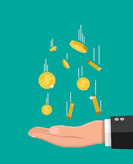 Moedas de ouro caindo e mão. Vetor Premium