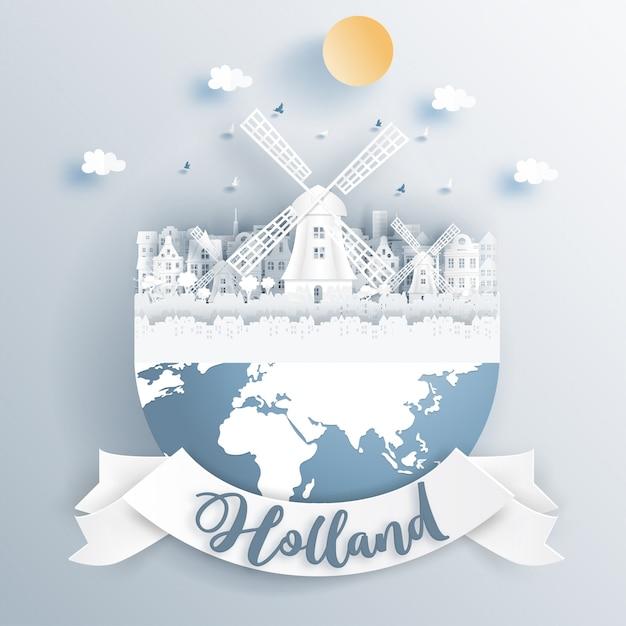Moinho de vento holandês da holanda com monumentos famosos na terra. Vetor Premium