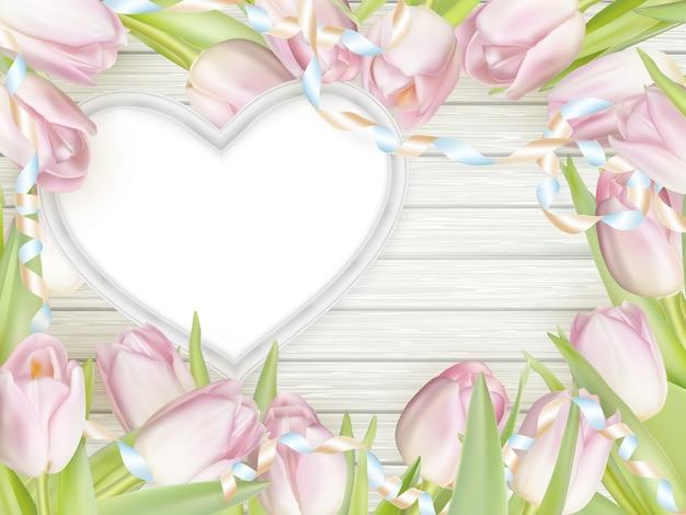 Moldura de forma de coração com tulipas. Vetor Premium