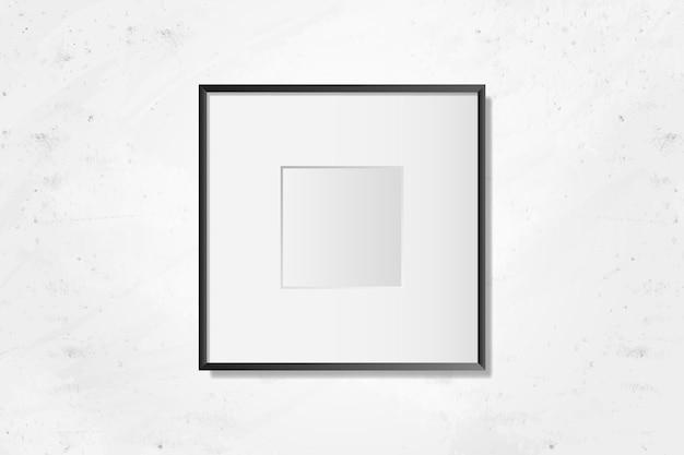 Moldura em branco preto na parede Vetor grátis