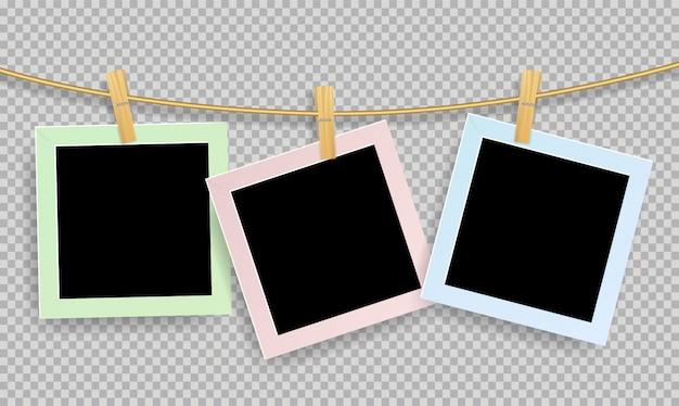 Molduras para fotos realistas retrô com clipe de papel de madeira Vetor Premium