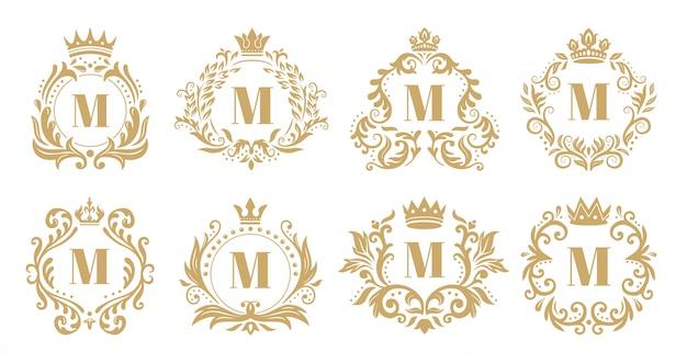Monograma de luxo. logotipo da coroa vintage, monogramas ornamentais dourados e coroa heráldica ornamento conjunto de vetores Vetor Premium