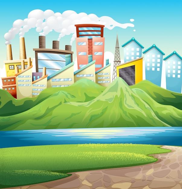 Montanhas verdes perto do rio e dos edifícios Vetor grátis