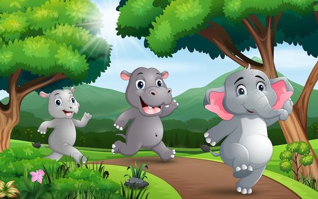 Muitos animais correndo ao longo da estrada Vetor Premium