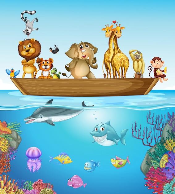 Muitos animais no barco de madeira Vetor Premium