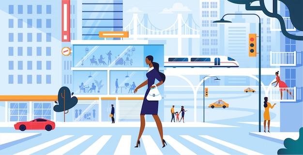 Mulher adorável nova no vestido à moda que anda ao longo da faixa de travessia na metrópole grande ocupada, estilo de vida do morador da cidade da menina, pressa no trabalho ou no tempo livre do fim de semana Vetor Premium