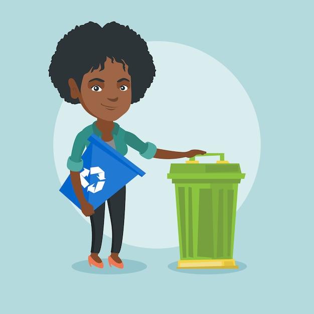 Mulher africana com reciclagem e lata de lixo. Vetor Premium