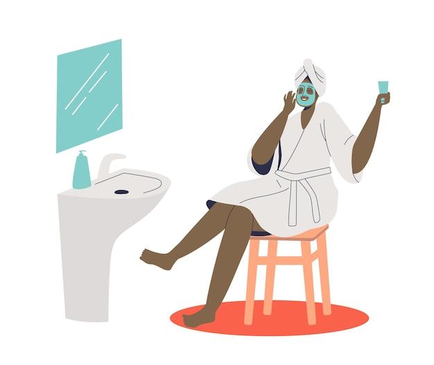 Mulher afro-americana fazendo procedimento de máscara de spa cosmética para cuidados com a pele do rosto Vetor Premium