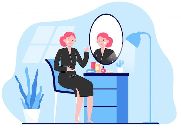 Mulher aplicar creme para enfrentar a pele no espelho Vetor grátis