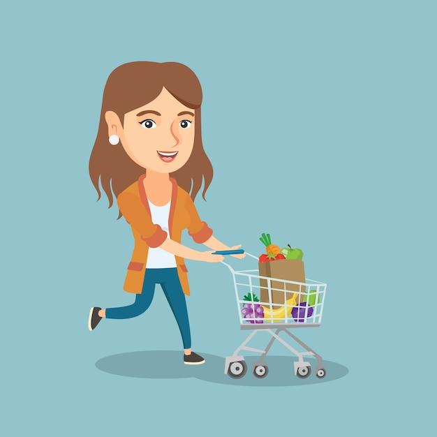 Mulher caucasiana, correndo com um carrinho de compras. Vetor Premium