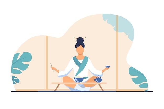 Mulher chinesa sentada à pequena mesa e comendo. chá, arroz, ilustração vetorial plana de pauzinho. tradição e conceito de nação Vetor grátis
