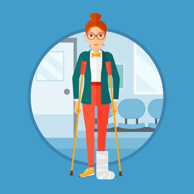 Mulher com a perna quebrada e muletas. Vetor Premium