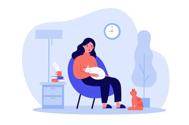 Mulher com gatos no apartamento acolhedor Vetor Premium