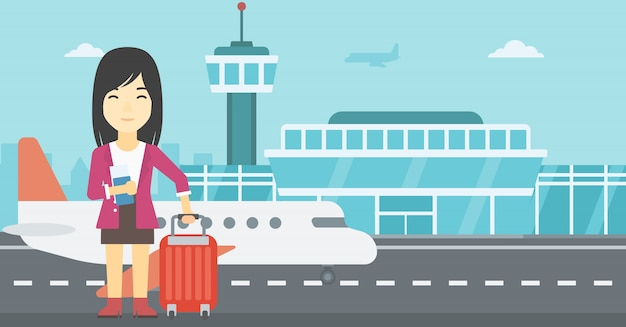Mulher com mala e bilhete no aeroporto. Vetor Premium