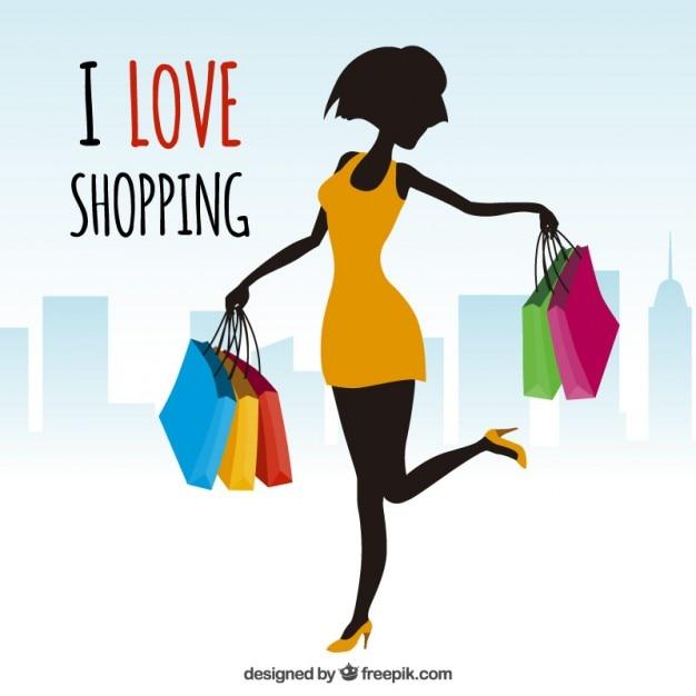 Mulher com sacos de compras Vetor grátis