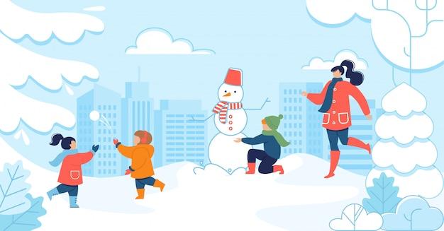 Mulher e filhos se divertem no parque nevado Vetor Premium