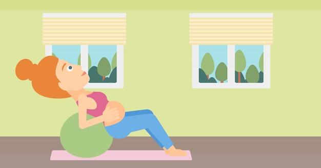 Mulher gravida na bola ginástica. Vetor Premium