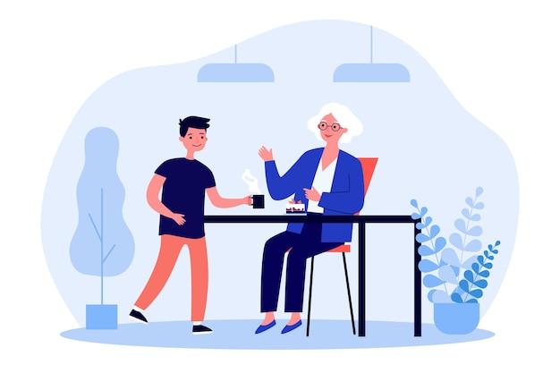 Mulher idosa sentada à mesa e o neto servindo chá para ela Vetor Premium