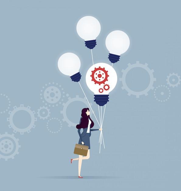 Mulher negócio, andar, com, quatro, voando, lâmpadas incandescentes Vetor Premium