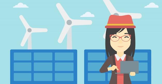 Mulher que verifica os painéis solares e as turbinas eólicas. Vetor Premium